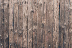 A strong wooden fence made of oak boards Stock Photos