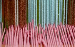 Strong woolen threads woven into the loom Royalty Free Stock Photography