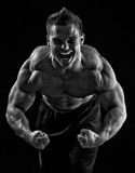 A strong, young adult male. Flexing. Black and white Royalty Free Stock Photos