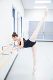 Strong young ballet dancer balancing on toes Royalty Free Stock Photography