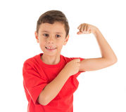 Strong young boy showing his left hand biceps muscle Stock Image