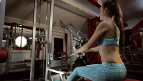 Strong young brunette woman training in sport gym. stock video