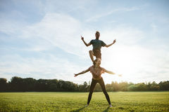 Strong young couple doing acrobatic yoga Royalty Free Stock Photo