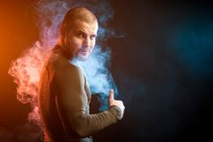 Athlete posing against smoke royalty free stock photography