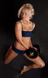 Strong young girl working out with dumbbells. Royalty Free Stock Image