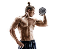 Strong young man doing exercises with dumbbells at biceps. Photo of sporty male with naked torso isolated on white background. Strength and motivation stock images