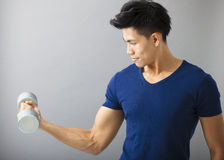 Strong young man with dumbbell Royalty Free Stock Photo
