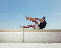 Strong young man exercising outdoors Royalty Free Stock Photo