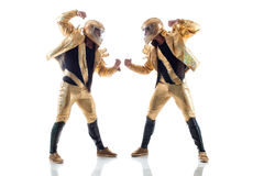 Strong young strippers posing in golden costumes Stock Image