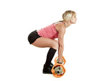 Strong young woman with barbell Royalty Free Stock Image