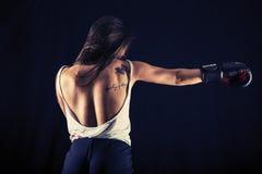 Strong young woman boxing performing a jab kick Royalty Free Stock Photo