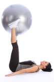 Strong young woman exercising legs with ball royalty free stock photo