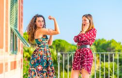 Girl power, hear me roar. Strong young women showing her muscles and physical strength. Girl power, girls are independent and powerful stock images
