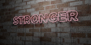 STRONGER - Glowing Neon Sign on stonework wall - 3D rendered royalty free stock illustration. Can be used for online banner ads and direct mailers Stock Photography
