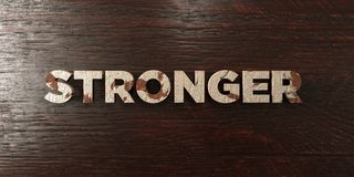 Stronger - grungy wooden headline on Maple  - 3D rendered royalty free stock image. This image can be used for an online website banner ad or a print postcard Royalty Free Stock Photos