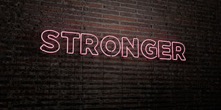 STRONGER -Realistic Neon Sign on Brick Wall background - 3D rendered royalty free stock image. Can be used for online banner ads and direct mailers Royalty Free Stock Photos