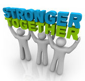 Stronger Together - Lifting the Words. Three men join forces to lift the words Stronger Together Royalty Free Stock Photos