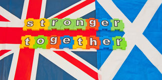 Stronger together. Union Jack flag alongside the Scottish Saltire with text ' stronger together ' in colorful jigsaw style letters relating to the independence Stock Images