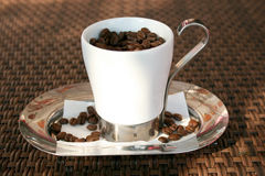 The strongest coffee. Cup of coffe filled with coffee beans Stock Photo