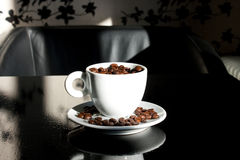 The strongest coffee. Coffee cup filled with roasted coffee beans Royalty Free Stock Photo