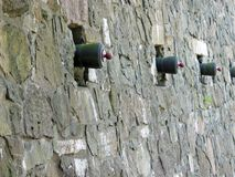 Stronghold. Stone wall of a stronghold with line of embrasures Royalty Free Stock Photos