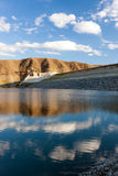 Stronghold of the Azat reservoir under cloudy sky. Reflection of the cloudy sky in blue waters of Azat reservoir in Ararat Marz Stock Photo