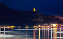 Stronghold of genoese over water Crimea, Sudak Stock Images
