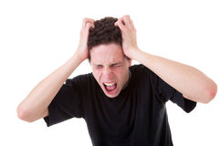 Strongly afflicted young man, screaming and pullin Stock Image