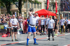 Strongman competitions raises dumbbell hand Royalty Free Stock Photo