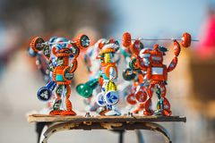 Strongman figurines made from bottle caps and sold on the promenade next to the beach by a loca Royalty Free Stock Photography