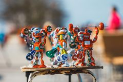 Strongman figurines made from bottle caps and sold on the promenade next to the beach by a loca Stock Images