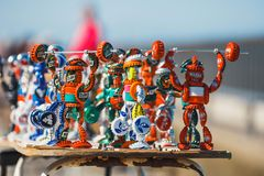 Strongman figurines made from bottle caps and sold on the promenade next to the beach by a loca Royalty Free Stock Image