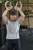Strongman with gymnastic rings Royalty Free Stock Image