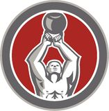 Strongman Lifting Up Kettlebell Circle Retro Stock Photo