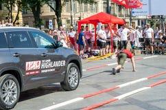 Strongman pulls Toyota Highlander Stock Images