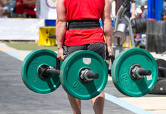Strongmen and heavy barbell. Strongmen in lifting heavy barbell Royalty Free Stock Images