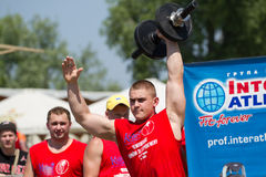 Stronmen compete in lifting heavy barbel Stock Photo
