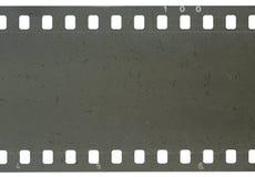 Strook van oude celluloidfilm met stof en krassen royalty-vrije stock afbeeldingen