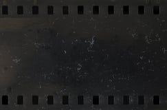 Strook van oude celluloidfilm met stof en krassen royalty-vrije stock afbeelding