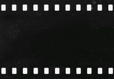 Strook van oude celluloidfilm met stof en krassen stock afbeelding
