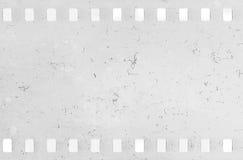 Strook van oude celluloidfilm met stof en krassen stock fotografie