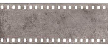Strook van oude film met stof en geïsoleerde krassen royalty-vrije stock afbeeldingen