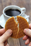 Stroopwafel split by hands Stock Images
