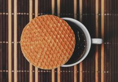 Stroopwafel on top of a cup of black coffee. Top view Royalty Free Stock Photography
