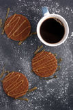 Stroopwafels with caramel sauce and coffee Stock Images