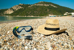 A strow hat, a swim mask and tube for diving under water Stock Photography