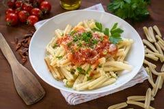 Strozzapreti with tomato sauce Royalty Free Stock Photos