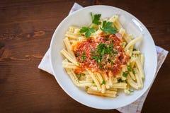 Strozzapreti with tomato sauce Stock Photos