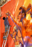 Street art in Santiago, Chile. An unknown street artist completes artwork on a building in Santiago, Chile. Santiagos streets feature many creative artworks Royalty Free Stock Photography