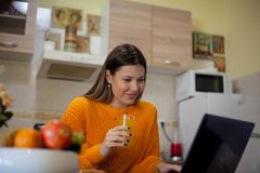 Strti ng morning with orange juice and online news royalty free stock images